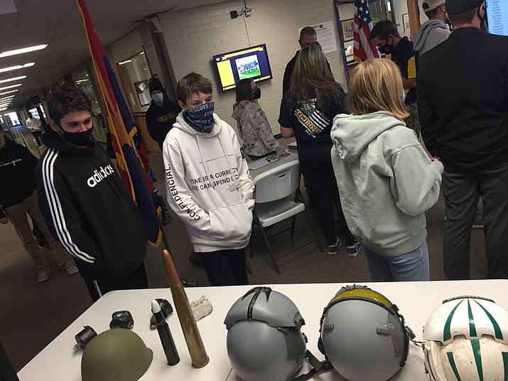Students view some of the other military equipment displayed as they then move to view the names as part of the Veterans Day events. (PUSD/Courtesy)