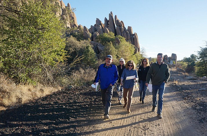 Prescott Recreation Services Director Joe Baynes, left, leads a tour of the Peavine Trail and the Point of Rocks Thursday, Nov. 19, 2020, for members of the city's Parks and Recreation board. The tour was intended to familiarize the board members with the area that is being reviewed for possible annexation into Prescott city limits. (Cindy Barks/Courier)