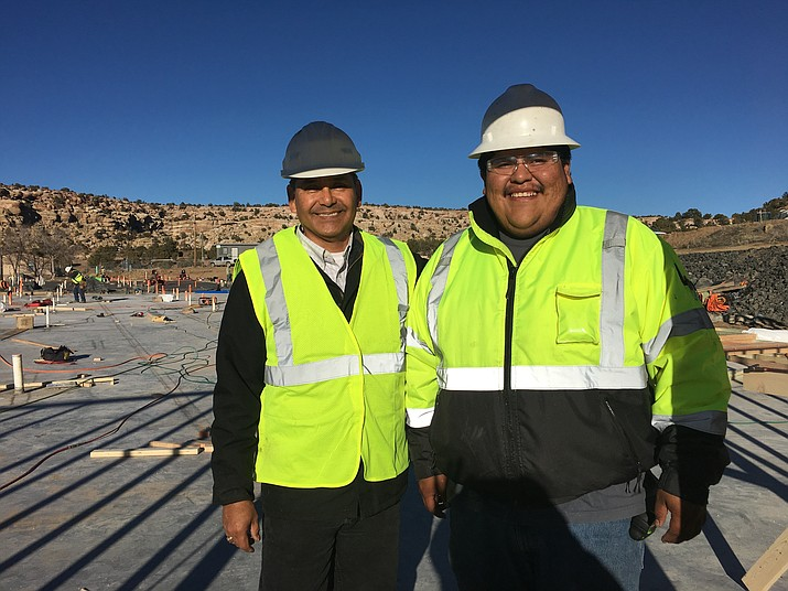 Darron  at a job site with Daryl Melvin. ((Photo courtesy of Melvin Consulting)