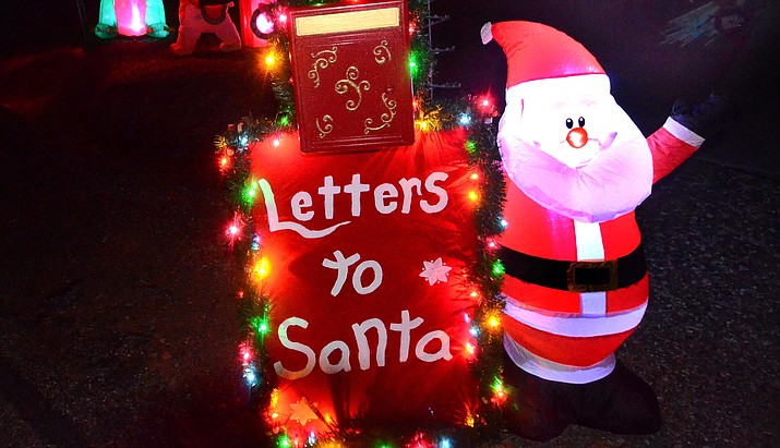 Santa's elves Matt and Tony Meili-Petzoldt have placed a mailbox to Santa in front of their Cottonwood home on South Desert Flower Circle. VVN/Vyto Starinskas