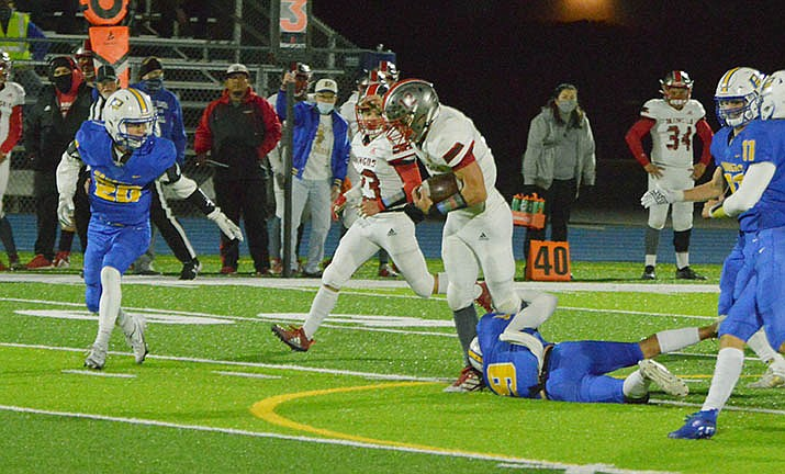 Drew Meyer tries to escape a leg tackle in a recent game. Meyer, a senior, is among three Mingus Union football players named to the 4A Grand Canyon All-Region First Team for 2020. VVN file photo