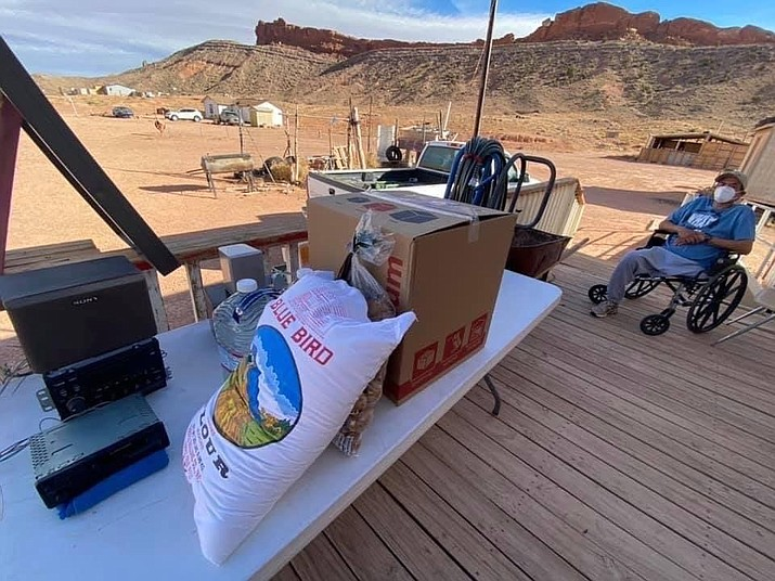 Shandiin Herrera and her family provide Kinship Care Packages to elders, immunocompromised, and struggling families, including Darell Whitehorse, in the Monument Valley area. 