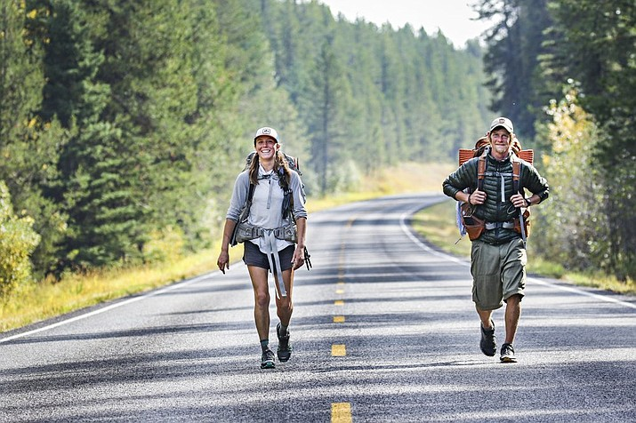 Peter Weinberger, 33, of Massachusetts, and Sarah Williams, 29, of Kalispell, Montana, walk north along Camas Creek Road in Glacier National Park, Montana in September during the last leg of their journey on the Continental Divide Trail. The route leads from the Mexican border to the Canadian Border. (Hunter D'Antuono/Flathead Beacon via AP)