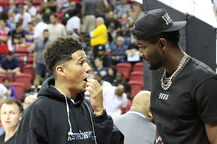 Devin Booker, left, and Deandre Ayton are excited that they will be playing with Chris Paul this season. (Cronkite News, file photo)