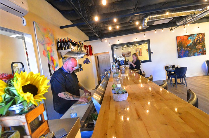Owner Christopher Dobrowolski and manager Dayna Swenson prepare for customers at the new chef's bar at Altrui in Cottonwood. VVN/Vyto Starinskas