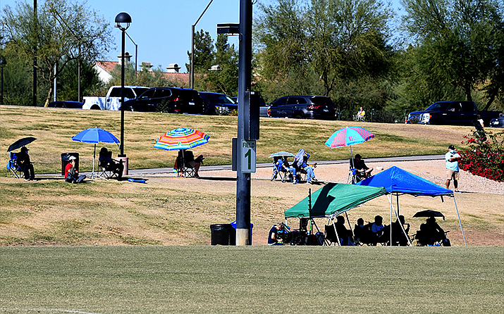 Arizona youth soccer fans often choose to socially distance themselves from others when watching matches. (Photo by Kevin Hurley/Cronkite News)