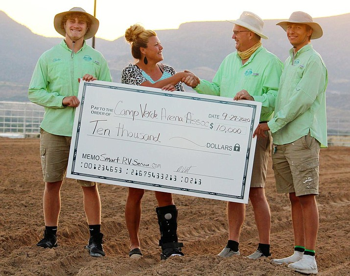 Camp Verde Arena Association President Mary Phelps accepts a $10,000 check from Gabe Meyers, Robert Witt and Mardquez Mestas, from left. Courtesy photo