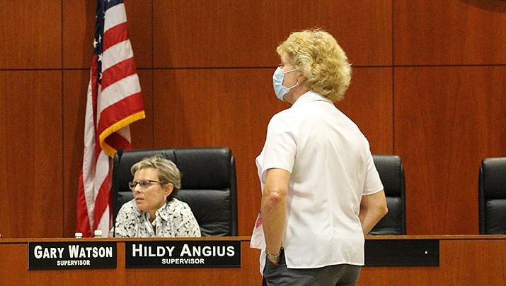 Mohave County Supervisor Hildy Angius of District 2, left, and Mohave County Public Health Director Denise Burley listen to a discussion at a board of supervisors meeting.  (Photo by Agata Popeda/Kingman Miner)