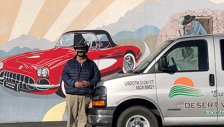 Bob Walton of Desert Wonder Tours poses for a photo with his tour van by the Mohave Museum of History and Arts at 400 W. Beale St. in Kingman. (Photo by Agata Popeda/Kingman Miner)