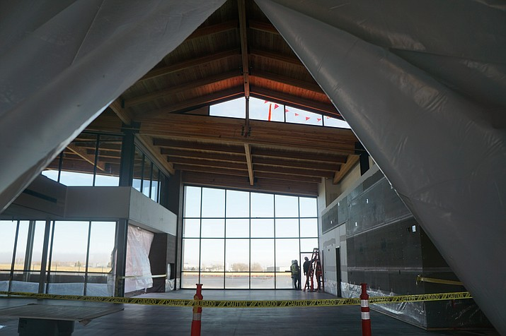 City officials say work on the new Prescott Regional Airport passenger terminal is moving into the final stages. On Dec. 11, 2020, crews were working throughout the project, including on the building's windows and doors. The city contracted with the team of Willmeng Construction and Fann Contracting to construct the $15 million project. (Cindy Bark/Courier)