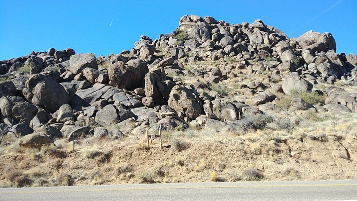 """This outcrop showing spheroidal weathering of granite is indicative of what Luis Vega calls """"John Wayne country."""" (Photo by Luis Vega/For the Miner)"""