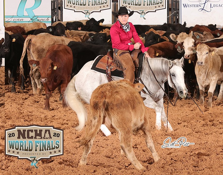 Prescott Valley resident Virginia Kilduff and her horse, Kisses On My Bottom, compete at the National Cutting Horse Association World Finals at the Will Rogers Memorial Complex in Fort Worth, Texas, earlier this month. The pair were named World Champions in the $35,000 Non-Pro class. (Seth Petit Photography via National Cutting Horse Association)
