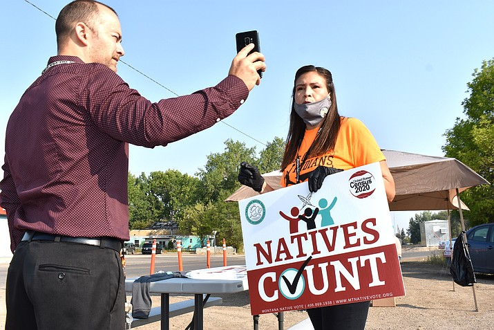 """Activist Lauri Dawn Kindness, right, speaks at the Crow Indian Reservation, in Lodge Grass, Montana. Native Americans make up less than 2 percent of the U.S. population and often are listed in datasets as """"other"""" or denoted with an asterisk.  (AP Photo/Matthew Brown, File)"""