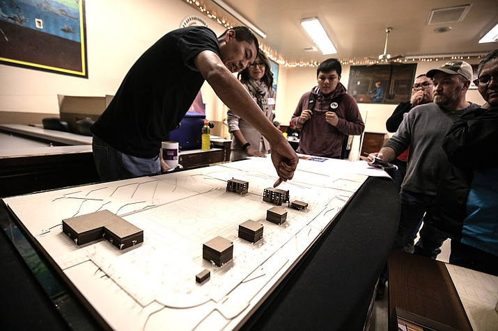 Change Labs participants look at a diagram during a community vision project in 2019. (Photo/Raymond Chee)