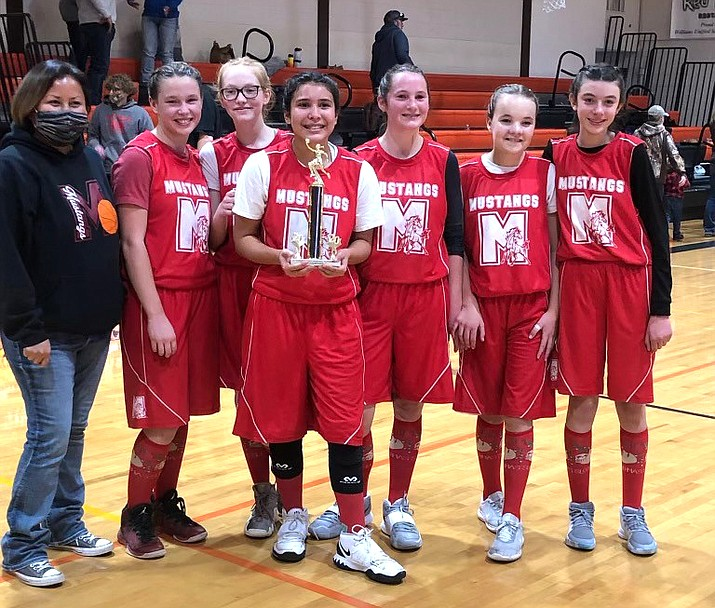 The Maine Consolidated School Mustangs 'A' team won the I-40 League tournament for the second year in a row Dec. 11 at Williams. The team consists of coach Andrea Betts, and players Kyleigh Amos, Stori Betts, Miranda Chaney, Madisyn Martinez, and Samantha Stafford. The team beat Ash Fork 44-30 to clinch the title. (Submitted photo)