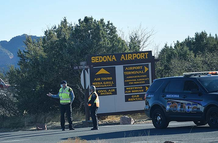 Officers wait for other law enforcement to arrive at Sedona Airport on Sunday afternoon. The Sedona Police Department, in a news release, said one 37-year-old man was shot by police when confronted about a possible stolen vehicle, and is in stable condition, and an officer suffered wounds as well. VVN/Jason W. Brooks