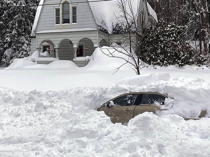 This photo, provided by the New York State Police, shows a car, in Owego, NY, from which a New York State Police sergeant rescued Kevin Kresen, 58, of Candor, NY, stranded for 10 hours, covered by nearly 4 feet of snow thrown by a plow during this week's storm. Authorities say the New York State Police sergeant rescued Kresen stranded for hours in a car covered by nearly 4 feet of snow thrown by a plow during this week's storm. The 58-year-old Candor man drove off the road and got plowed in by a truck. (New York State Police via AP)