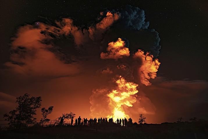 People watch an eruption from Hawaii's Kilauea volcano on the Big Island Dec. 20. (Janice Wei/National Park Service via AP)