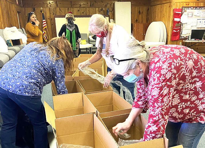 ESA members package boxes to be sent to servicemen and women. (Wendy Howell/WGCN)