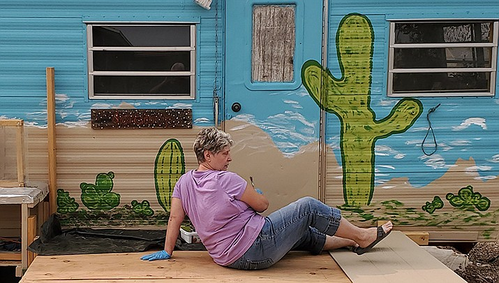 Debra Guzman of Golden Valley works on her She Shed this summer. (Courtesy photo)