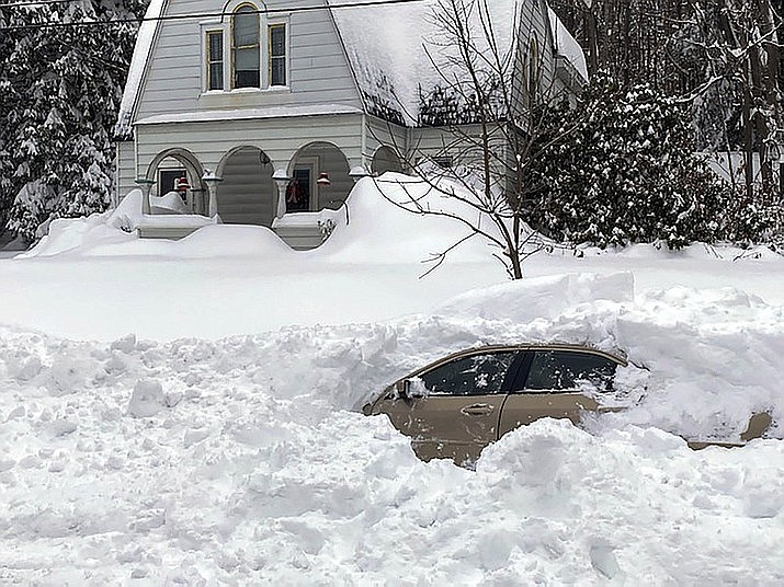 This photo shows a car, in Owego, N.Y., from which a New York State Police sergeant rescued Kevin Kresen, 58, of Candor, NY, stranded for 10 hours, covered by nearly 4 feet of snow thrown by a plow during this week's storm. (New York State Police via AP)
