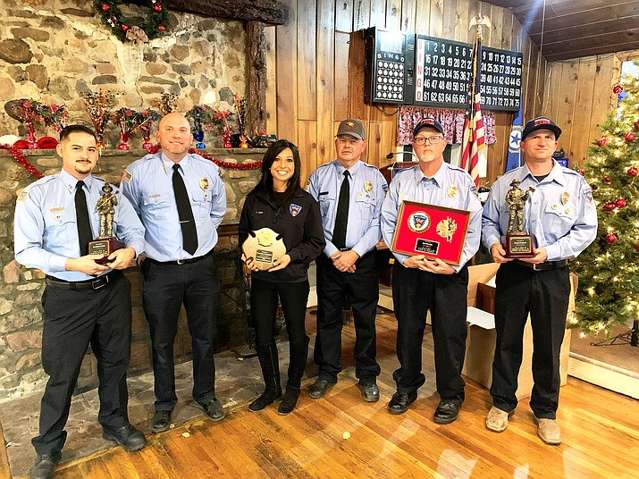 From left: Robert Ortiz, Kevin Schulte, Loretta McKenney, Ian James, Jeff Pettit and Chase Pearson attend the 2020 Williams Fire Department Christmas party. Ortiz and Pearson received 15 year service awards, Pettit received a 20 year award and McKenney was named 2020 Firefighter of the Year for the department. (Loretta McKenney/WGCN)