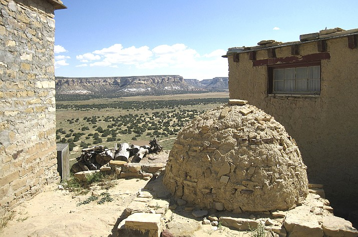 This October 2012 photo shows a view from the Acoma Pueblo in New Mexico. The ancient pueblo has been inhabited for centuries by the Acoma people. The location is featured in a collection of mini-essays by American writers published online by the Frommer's guidebook company about places they believe helped shape and define America. (AP Photo/Beth J. Harpaz, File)