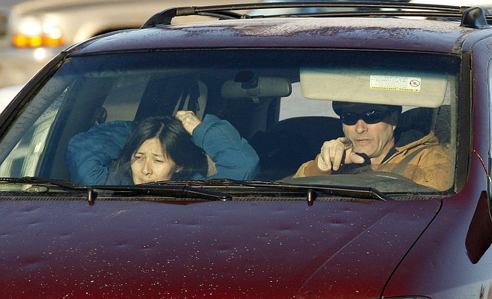 In this Jan. 11, 2010, file photo, Richard Heene, right, and his wife, Mayumi, arrive at the Laramie County Detention Center in Fort Collins, Colo. The couple convicted of criminal charges in the so-called balloon boy hoax that fascinated the country more than a decade ago was pardoned Wednesday, Dec. 23, 2020, by the governor of Colorado. (AP Photo/ Ed Andrieski, File)