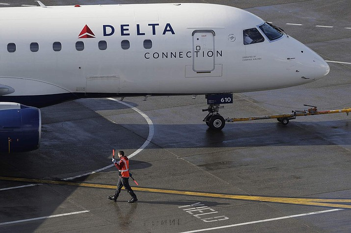 According to airline officials, a Delta flight out of New York City last Tuesday was halted after a Florida couple traveling with a Great Dane puppy fled the aircraft with the pet using an emergency slide. (AP Photo/Ted S. Warren, File)