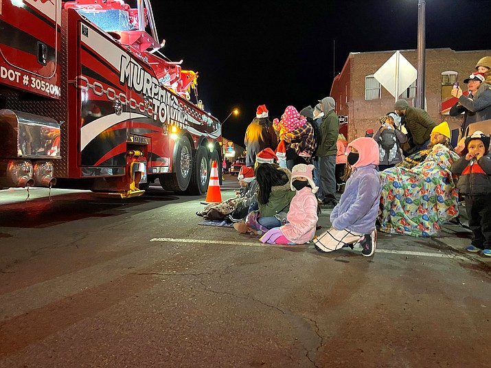 Murphey's Towing cruises down Route 66 in Williams during the annual Light Parade. (Wendy Howell/WGCN)