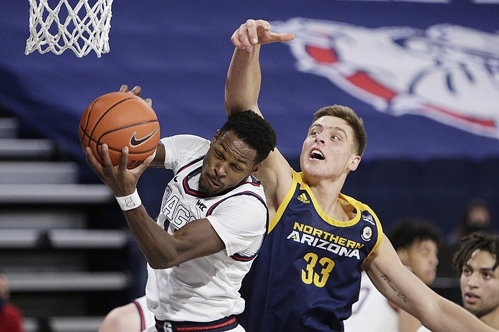Gonzaga guard Joel Ayayi, left, grabs a rebound in front of Northern Arizona forward Carson Towt during the first half of an NCAA college basketball game in Spokane, Wash., Monday, Dec. 28, 2020. (Young Kwak/AP)