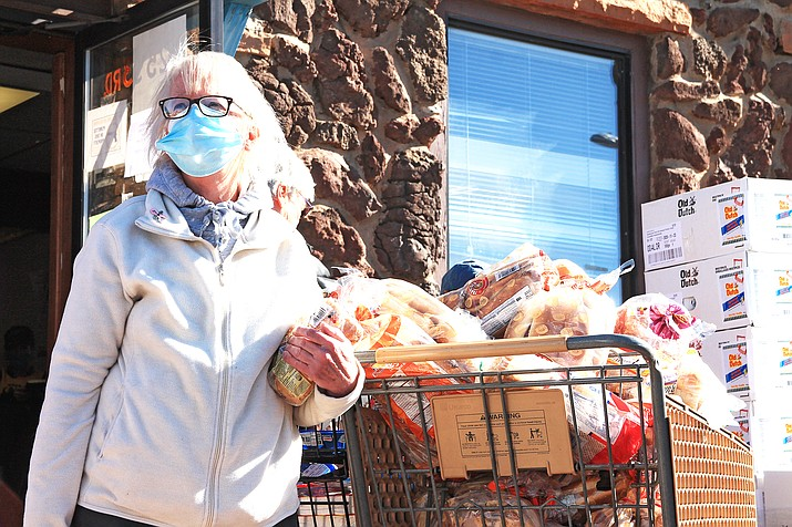 Mary Smith gathers items during a distribution at Williams Food Pantry and More Dec. 23. Williams Food Pantry and More is asking for the community's help in finding a new location for its operation. (Loretta McKenney/WGCN)