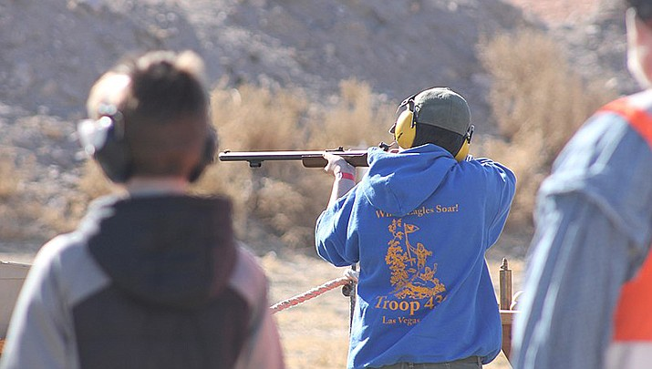 The Church of Jesus Christ of Latter-day Saints was hit with several lawsuits Monday for allegedly covering up decades of sexual abuse among Boy Scout troops in Arizona, marking the latest litigation before the state's end-of-year deadline for adult victims to sue. Boy Scouts are shown above shooting a blackpowder rifle at a jamboree. (Photo by Noah Wulf, cc-by-sa-4.0, https://bit.ly/3nJz86X)