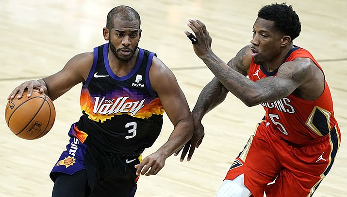 Phoenix Suns guard Chris Paul (3) drives on New Orleans Pelicans guard Eric Bledsoe during the second half of an NBA basketball game Tuesday, Dec. 29, 2020, in Phoenix. (AP photo/Rick Scuteri)