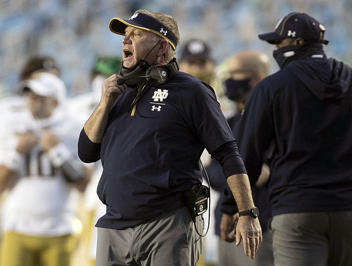 In this Nov. 27, 2020, file photo, Notre Dame head coach Brian Kelly directs his team during the second quarter of an NCAA college football game against North Carolina at Kenan Stadium in Chapel Hill, N.C. (Robert Willett/The News & Observer via AP, File)
