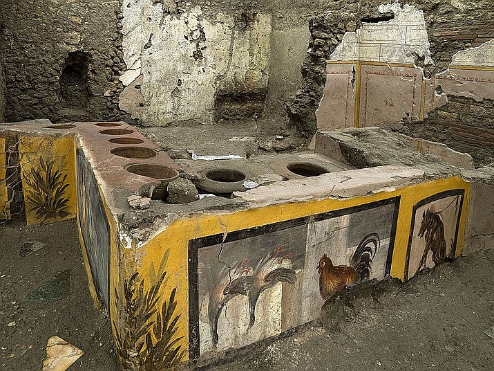 An undated photo made available by the Pompeii Archeological park press office shows the thermopolium in the Pompeii archeological park, near Naples, Italy. A fast-food eatery discovered at Pompeii is now completely excavated, helping to reveal some favorite dishes of citizens of the ancient Roman city who liked to eat out. (Luigi Spina/Parco Archeologico di Pompei via AP)
