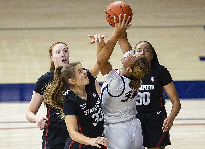 Arizona forward Lauren Ware (32) reaches for a rebound as Stanford guard Hannah Jump (33) tries to keep her from getting the ball during an NCAA college basketball game Friday, Jan. 1, 2021, in Tucson, Ariz. (Josh Galemore/Arizona Daily Star via AP)
