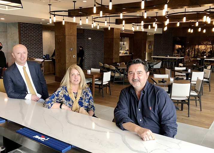The new Hilton Garden Inn opened in downtown Prescott in mid-December 2020, featuring a locally operated restaurant and lounge, the Triple Creek Kitchen and Spirits. From left, developer Shane Shumway, General Manager Marci Hurlbert and Food and Beverage Director Barry Barbe met up at the hotel this past week, and emphasized the focus on local history and creekside setting. (Cindy Barks/Courier)