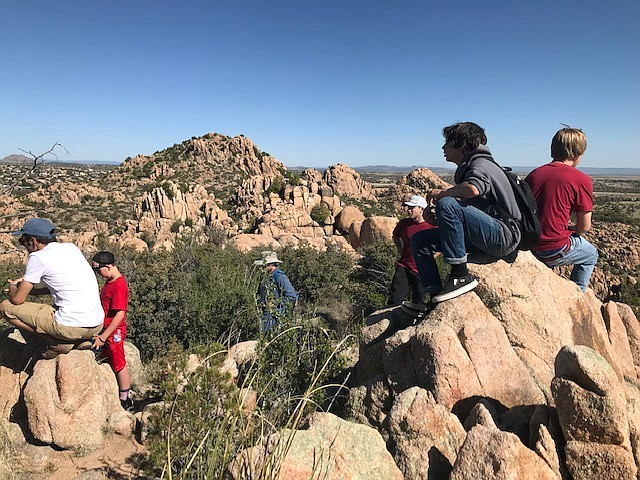 A group of teen boys and adult mentors who are part of a local mentoring circle on a 2019 fall hike along the Constellation Trails. Outdoor activities are part of the program. (Boys to Men/Courtesy)