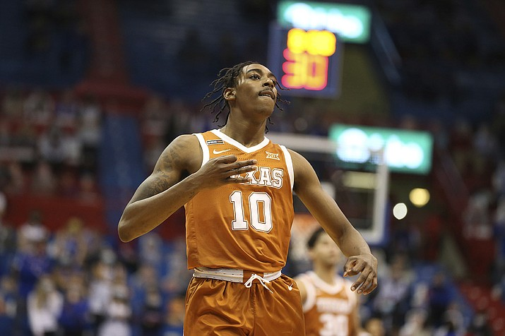 Texas guard Donovan Williams motions after scoring against Kansas in the second half of an NCAA college basketball game Saturday, Jan. 2. 2021, in Lawrence, Kan. (Evert Nelson/The Topeka Capital-Journal via AP)