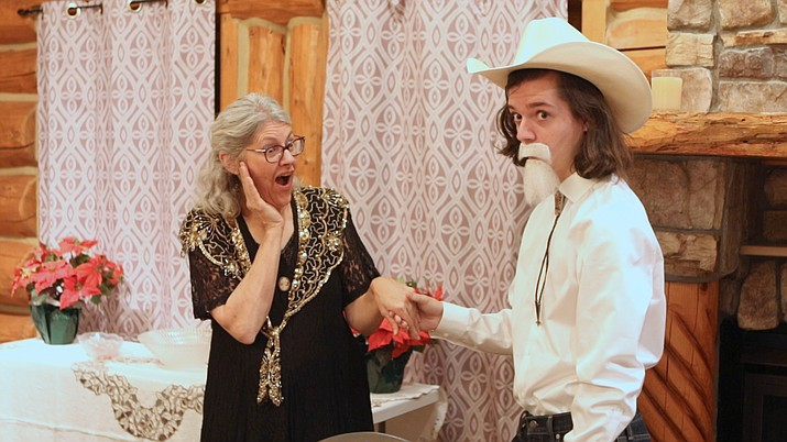 """Chino Valley Repertory Theatre cast members Jami Lewis, left, and Parker Schaible play their parts during filming of """"The Cowhand's Christmas Carol"""" at the Log Cabin on Highway 89. Jeff Frohock, founder and creative director at the Chino Valley Repertory Theatre, produced and directed this silent film for the holidays. (Matt Santos/Courtesy)"""