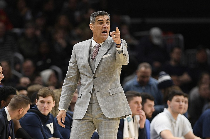 Villanova head coach Jay Wright gestures during the first half of an NCAA college basketball game against Georgetown in Washington, in this Saturday, March 7, 2020, file photo. Villanova coach Jay Wright was set to return to practice Tuesday following his bout with COVID-19. Those plans are on hold after two players tested positive Monday, Jan. 4, 2021, and the Wildcats were forced to postpone their next three games. (Nick Wass, AP File)