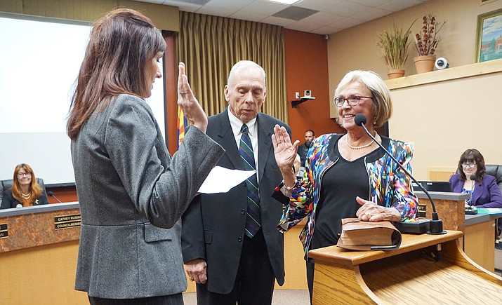 Incumbent Councilwoman Billie Orr is sworn into office by Yavapai County Superior Court Judge Krista Carman, while Orr's husband Bob, center, looks on in November 2019. Orr has resigned from the Prescott Council, effective Jan. 19, 2021. (Cindy Barks/Courier, file)