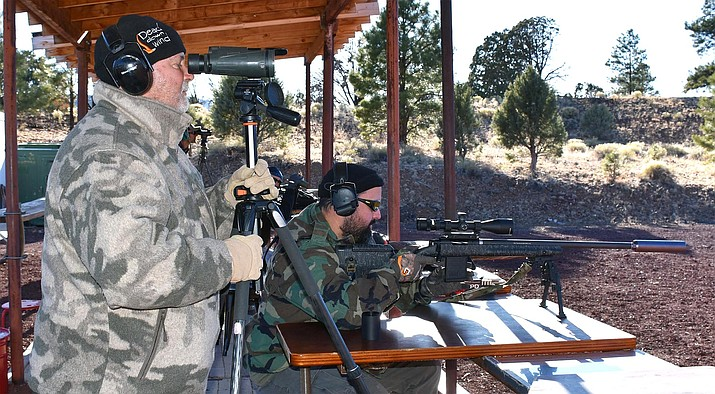 Members of Combat Warriors Inc. sight their rifles during a visit to the Williams Shooting Range in December. (Photo/Williams Sportsman's Club)