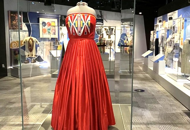 "Isabella Aiukli Cornell's 2018 prom dress is on display in ""Girlhood,"" a new exhibit at the Smithsonian National Museum of American History. Designer Della Bighair-Stump chose red to bring attention to the peril faced by Indigenous women. (Emma Sears/Gaylord News)"