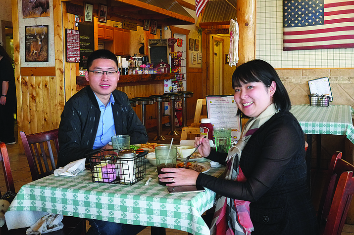 A couple enjoys a meal at Pine Country Restaurant in Williams. Many businesses are set to bump wages in 2021. (Loretta McKenney/WGCN)