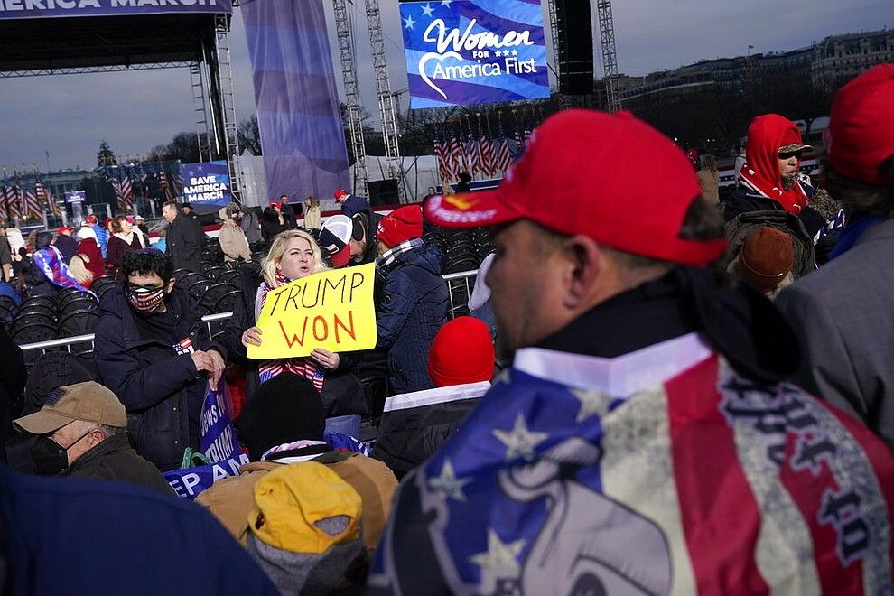 "With the White House in the background, people arrive to listen to speakers Wednesday, Jan. 6, 2021, in Washington, at a rally in support of President Donald Trump called the ""Save America Rally."" (AP Photo/Jacquelyn Martin)"