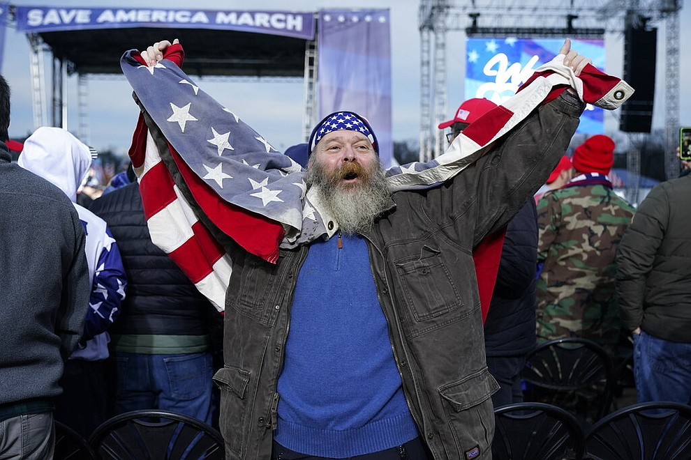 "Joseph Baker of Cape May, N.J., cheers as he waits for speakers Wednesday, Jan. 6, 2021, in Washington, at a rally in support of President Donald Trump called the ""Save America Rally."" (AP Photo/Jacquelyn Martin)"