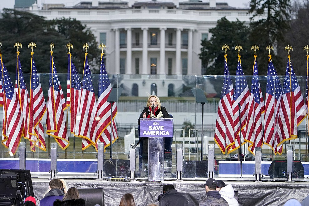 "With the White House in the background, Pastor Paula White leads a prayer Wednesday, Jan. 6, 2021, in Washington, at a rally in support of President Donald Trump called the ""Save America Rally."" (AP Photo/Jacquelyn Martin)"