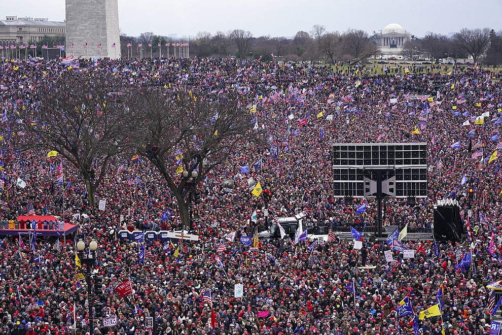 With the Washington Monument in the background, people attend a rally in support of President Donald Trump near the White House on Wednesday, Jan. 6, 2021, in Washington. (AP Photo/Jacquelyn Martin)